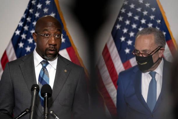 Senator Raphael Warnock and Chuck Schumer